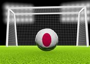 Stock Illustration of soccer japan flag over soccer ball, in front of the net, 3d render