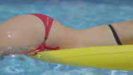 Stock Video Footage of Sexy body floating in pool with red bikini