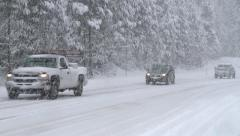 DRIVERS COMMUTERS IN HEAVY SNOW STORM CALIFORNIA SIERRAS TAHOE Stock Footage