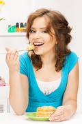 lovely housewife at the kitchen with sweets - stock photo