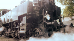 Steam engine. train locomotive. nostalgic. smoke puffing Stock Footage