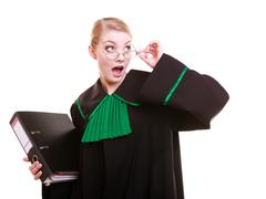 Surprised lawyer attorney wearing classic polish black green gown with folder Stock Photos