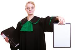 Woman lawyer attorney in classic polish gown holds clipboard blank sign Stock Photos