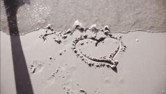Heart Washed Away On Sandy Beach Stock Footage