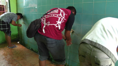 Three Muslim men wash before prayer Stock Footage