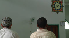 Two men in mosque in Indonesia Stock Footage