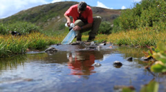 Stock Video Footage of Camper Refilling Water Canteen