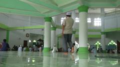 Men listen to sermon in Mosque Stock Footage