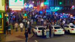 Timelapse of Beale Street, Memphis, police, neon signs, crowds Stock Footage