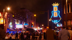 Beale Street in Memphis, summer night, neon signs, crowds, B.B. Kings club Stock Footage
