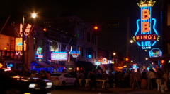 Summer Night on Beale Street in Memphis, neon signs, crowds Stock Footage