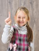 Girl shows his index finger upwards Stock Photos
