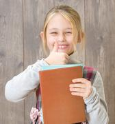child holding a book - stock photo