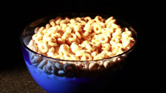 Cereal in Bowl thats Blue Glass Isolated on Black Stock Footage