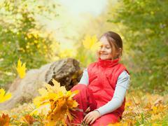 girl  falling  maple leaves - stock photo