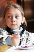 Little girl eating dessert Stock Photos