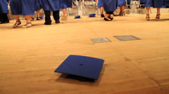 Awesome shot of Graduation Cap Being Picked Up After Ceremony Stock Footage