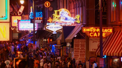 Beale Street, Memphis, night, neon lights, crowds Stock Footage
