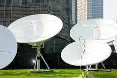 Parabolic satellite dish receivers Stock Photos