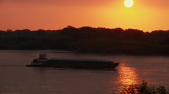Tug pushing a barge on the Mississippi River at sunset, Summer, Memphis TN Stock Footage
