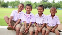 Four Asian Grade School Students - Tilt Up Stock Footage