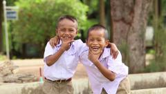 Two Cute Asian Grade School Students Mugging For The Camera Stock Footage
