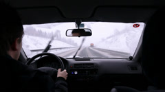 Driving by a snow plowing truck on highway - stock footage