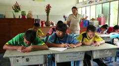 Thai Teacher Checking On Her Students During Test Stock Footage