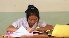 Asian Female Student Works On Her Assignment - stock footage