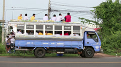 Asian Students Taking The Bus Home From School Stock Footage