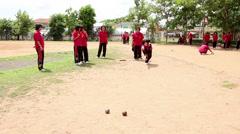 Thai Students Enjoy Playing Bocci Ball During School Break Stock Footage