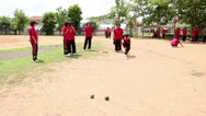 Stock Video Footage of Thai Students Enjoy Playing Bocci Ball During School Break