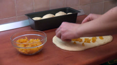 Woman fills dough with candied orange, homemade cake, Panettone, bread loaf Stock Footage