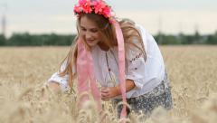 Young Girl Wearing Ukrainian Flower Wreath Collecting Bunch of Wheat Ears HD Stock Footage