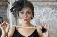 Stock Photo of pin up girl with pearl necklace