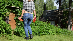 Farmer woman walk to basement house with preserved food jars Stock Footage