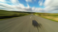 Driving car on the road in green fields, blurred timelapse 4K Stock Footage