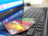 Stock Illustration of online purchase. credit card on laptop keyboard.
