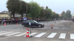 Driving bmw car on slalom autocross competition people audience Stock Footage