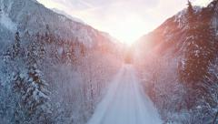 Road trough forest. beautiful winter snow landscape. sunset. fly over Stock Footage