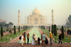 Tourists in taj mahal - famous mausoleum in india Stock Photos