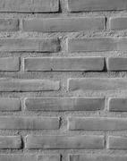 Brick-encased wall - background Stock Photos