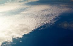 Beautiful white cirrus clouds on the deep blue sky - stock photo