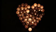 Heart shape made of candles Stock Footage
