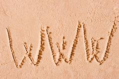 www written on wet sand at the sea - stock photo
