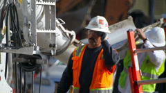 Concrete mixer truck worker prepares the machinery at construction site Stock Footage