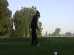 Early morning golf drive Stock Footage