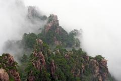 Generic chinese landscape - mist rising over huang shan Stock Photos