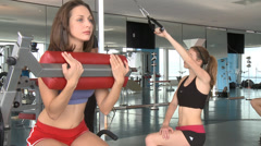 2 Girls and A Guys at the Gym Stock Footage