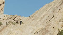 Girl Hiking up Rocks Stock Footage